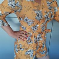 jumpsuit korte mouw oranje met bloemen XL