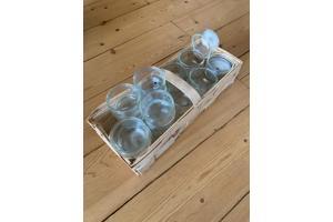 Glazen potjes voor waxinelichtjes